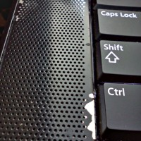 Photo of Dell Precision Laptop with yucky peeling paint on the keyboard!