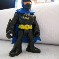 Mini-Batman stands tall! But can he scale metal walls?!