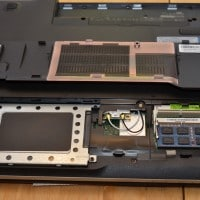Easy access to components once the panel is removed! [the HDD caddy is secured by four screws and has a pull tab for removal]