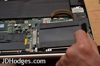Gently pull the hard drive out using the pull-tab