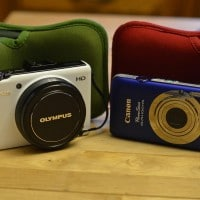 Two of my favorite cameras EVER: white Olympus XZ-1 and blue Canon ELPH 100 HS