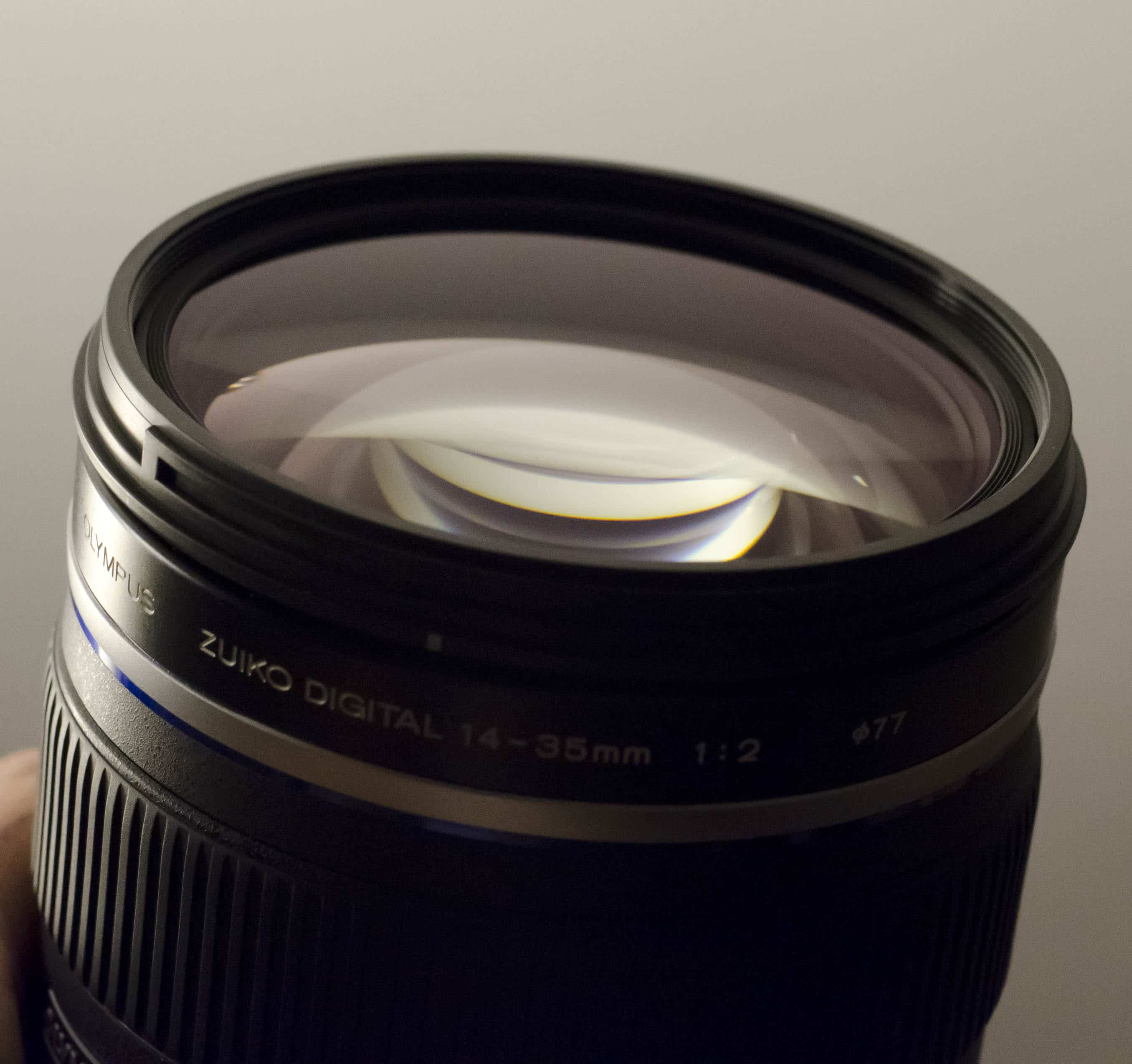 Olympus 14-35mm lens front glass