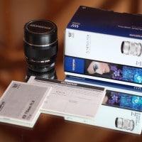 Olympus 75mm lens, box, warranty card, manual